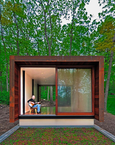 <p>A country western musician uses this retreat, made of exposed concrete and steel, glass, and wood, as a studio for writing and recording his music.</p>