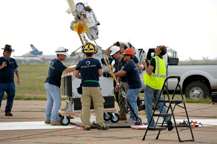 <p>The World View team prepares a 450-lb payload to be carried via high-altitude balloon to 120,000 ft during scaled test flight.</p>