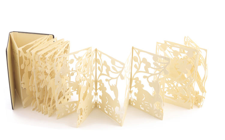 <p>Tord Boontje cut an accordion notebook into intricate floral filigree.</p>