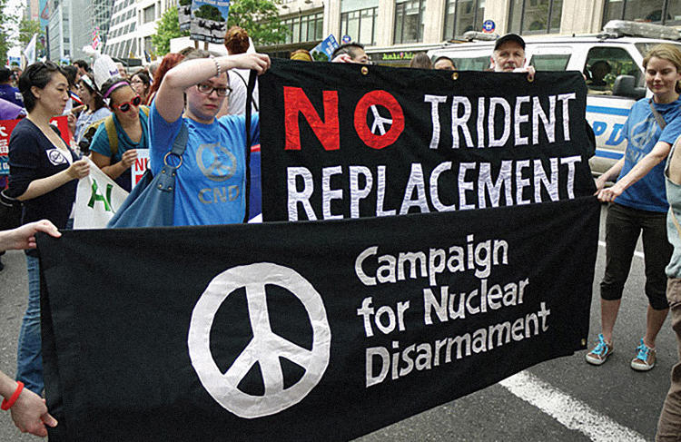 <p>That same year, protesters calling for the withdrawal of troops from Afghanistan also adopted the symbol, using it to striking effect on a series of 'Time to Go' placards.</p>