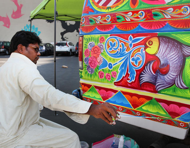 <p>Haider Ali, fine tunes a Ford Van for his USC Pacific Asia Museum 2014 commission.</p>
