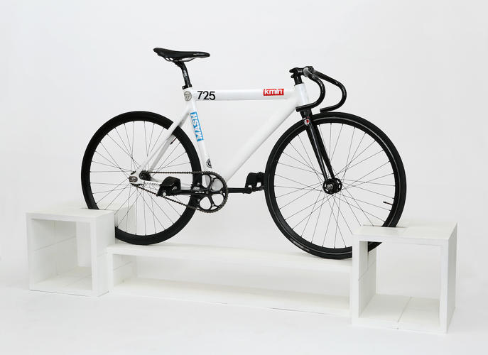 <p>But each piece is designed with a groove that easily balances two wheels. Instead of displaying the usual living room centerpiece—a television—you can display your transportation.</p>