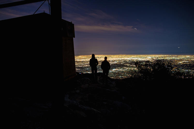 <p>Harun Mehmedinovic (L) and Gavin Heffernan (R) capturing light pollution (SKYGLOW) over downtown Los Angeles. Taken from Mount Wilson, Ca 2015.</p>