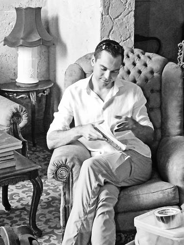 <p>Airbnb cofounder Nathan Blecharczyk flips through a guest book at an Airbnb property in Havana.</p>