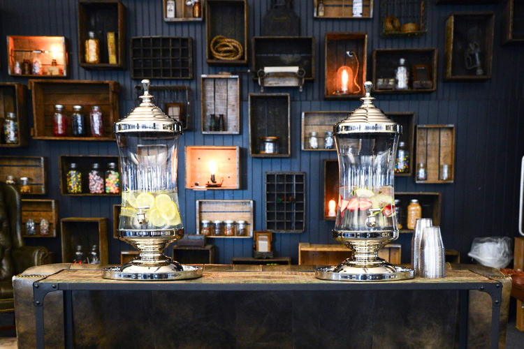 <p>The found crates and baskets were used to create a snack wall with vintage flair. The vintage aesthetic embodies the spirit and vibe of the Fueled Collective office.</p>