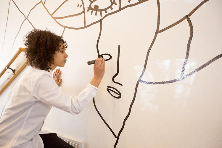 <p>Shantell Martin starts a drawing by drawing lines until she recognizes shapes that give her clues: A face gets eyes and a mouth. A horizon gets trees and a sun.</p>