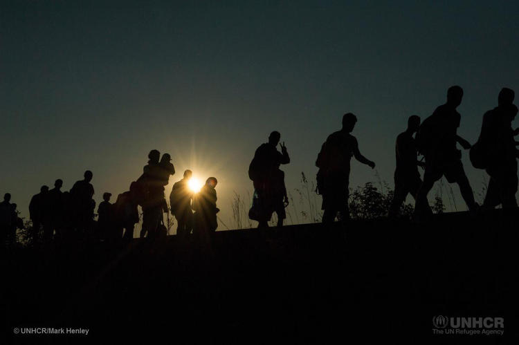<p>Refugees walking along an old railway line, having just crossed the Serbian/Hungarian border on foot, through a gap in the new border fence.</p>