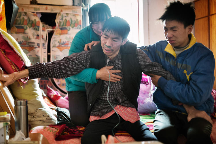 <p>&quot;After collapsing twice in one day, Chinese gold miner He Quangui is struggling to breathe, gripping the bed and his son He Jinbo's thigh while his wife Mi Shixiu holds him, crying. He eventually recovers his breath. But in the early hours of the next morning, he attempted suicide to end the suffering.&quot;</p>