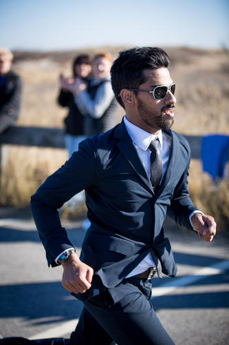 <p>Menswear company Ministry of Supply cofounder <strong>Gihan Amarasiriwardena</strong> crosses the Half MerryThon finish line, clocking in at 1:24:41 and setting the Guinness world record for fastest half marathon run in a suit.</p>