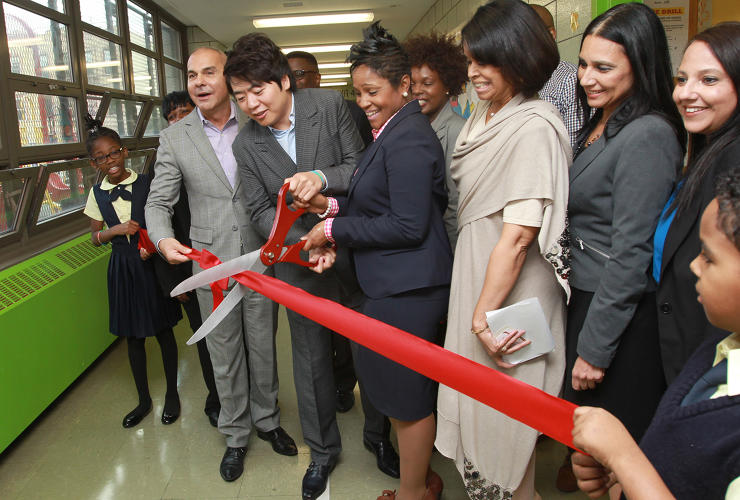 <p>Lang Lang cuts the ribbon on the new piano lab at PS 13: Roberto Clemente in Brooklyn, New York.</p>