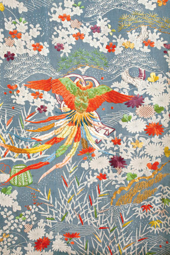 <p>Kimono for a woman (kosode). Landscape with a feather cape (detail).<br /> Plain weave crepe silk (chirimen); freehand paste-resist dyeing (yūzen), stencil 				imitation tie-dyeing (suri-hitta) and embroidery in silk and metallic threads.<br /> Edo period, 1800–50, 172.0 x 129.5 cm, KX186.</p>