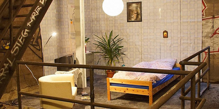 <p>This room, on the Berlin Metro's line 9, is furnished with an Ikea bed, a potted plant, an easy chair, and even a TV, wallpaper, and art.</p>