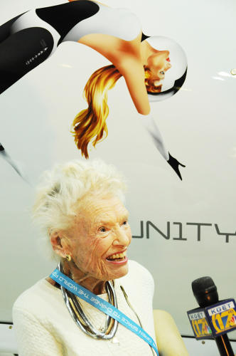 <p>Branson's mother underneath the Virgin Galactic logo, which includes an image of a woman--whose face is modeled on a younger version of her.</p>