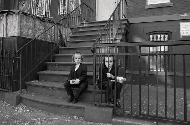 <p><em>Two Boys Sitting on Stairs</em> on Lee Avenue</p>