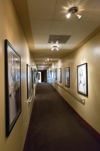 <p>Winners are whisked around backstage and through this walkway of giant black-and-white photos of past recipients.</p>