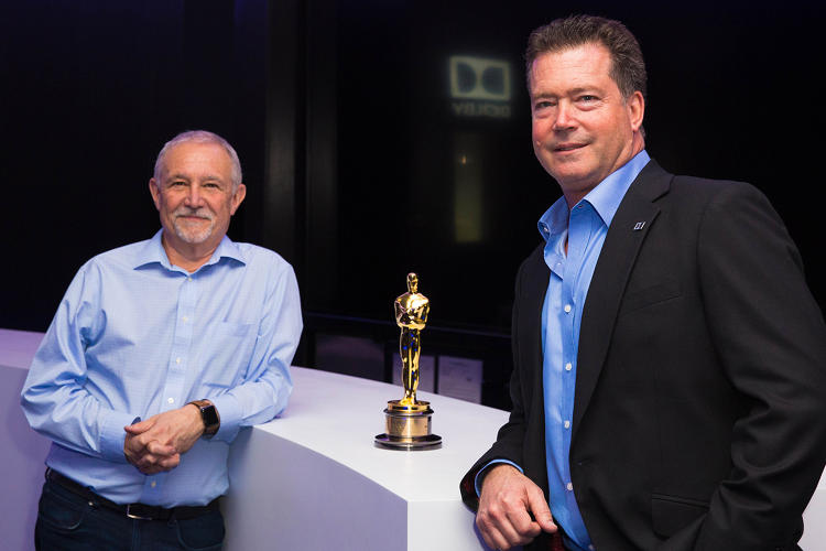 <p>Dolby's Steve Venezia and Curt Behlmer with the Ray Dolby Oscar</p>