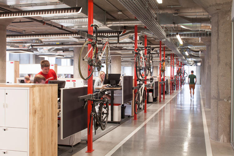 <p>To get the employees involved with the new office, SRAM hosted a competition to design bike simple racks near the workstations.</p>