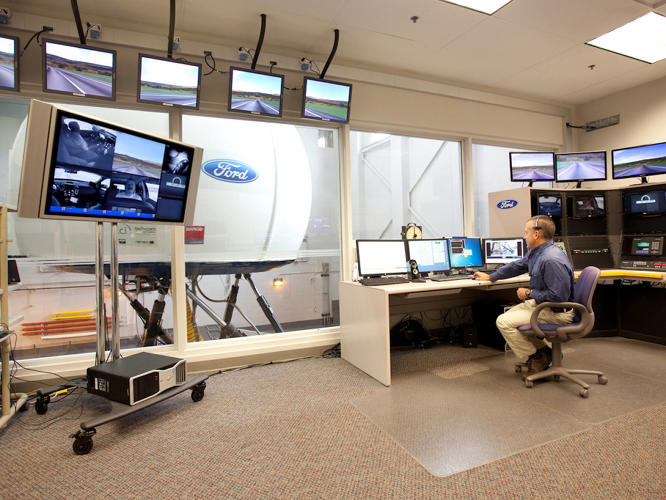 <p>The monitoring room outside of the VR dome, where researchers watch camera feeds of user behavior.</p>