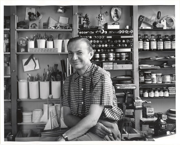 <p>Alexander Girard, in his studio in the early 1950s, photographed by Charles Eames</p>
