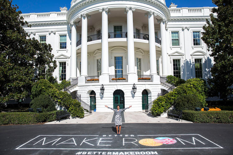 <p>First Lady Michelle Obama poses with chalk art for the public awareness campaign &quot;Better Make Room&quot; as part of her Reach Higher initiative</p>