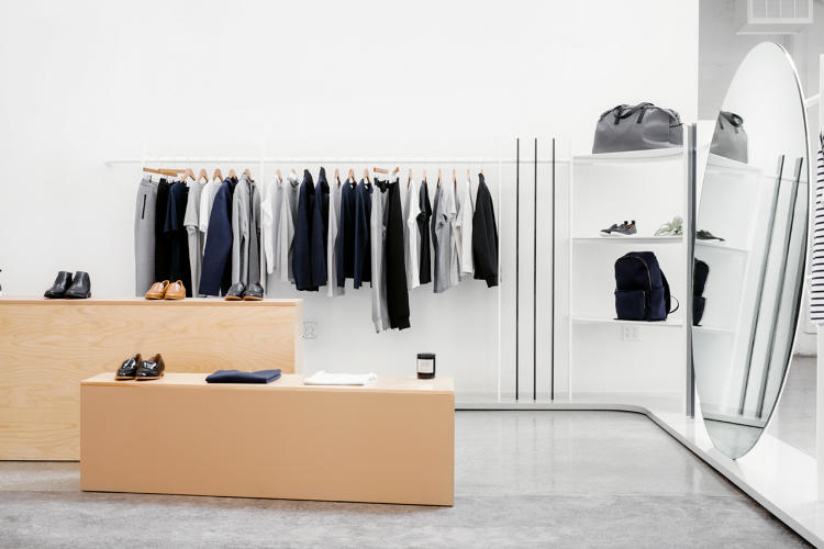 <p>Every piece from the collapsible fitting room to the leather wrapped display tables was designed custom for the Everlane showroom.</p>