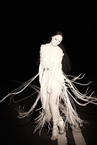 <p>A still from the 2010 Rodarte and Joyce Maggie Cheung film created by Wing Shya</p>