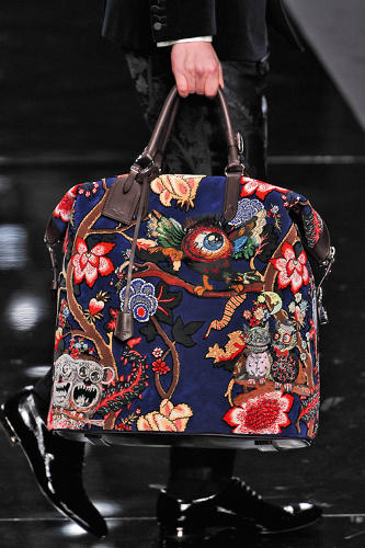 <p>A detail of a men's tote covered in the Chapman Brothers' &quot;Garden in Hell&quot; print for the Louis Vuitton fall/winter 2013 men's collection</p>