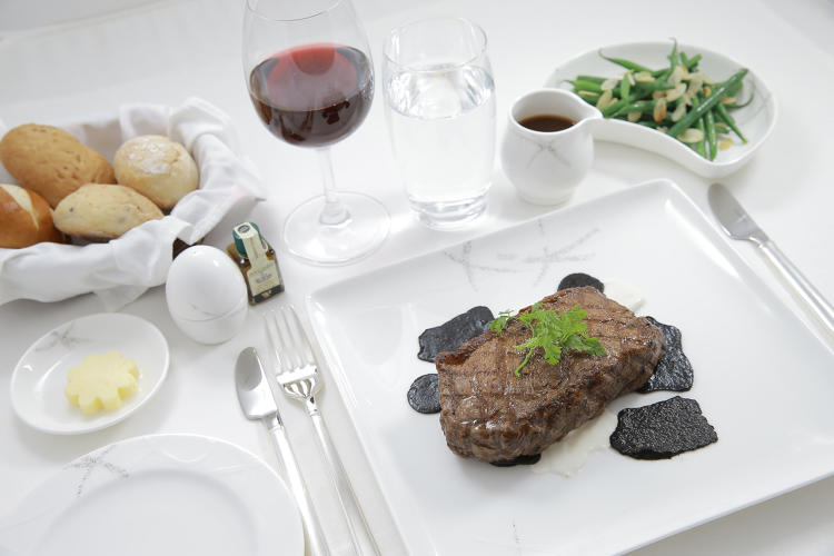 <p>Pan-seared Kobe A4 rib eye, black Australian truffle, artichoke paste and fondant potatoes—Cathay Pacific</p>