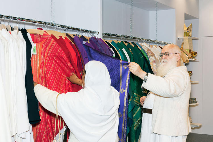 <p>Shopping (Clergy people picking clothing)</p>