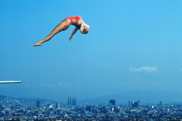 <p>Barcelona 1992: Tracey Miles of Great Britain high over the Sagrada Familia during a diving competition.</p>