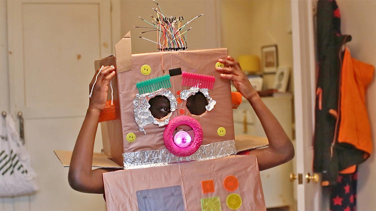 <p>Here, a kid has created a cardboard robot costume and has programmed the LEDs to light up when she moves.</p>