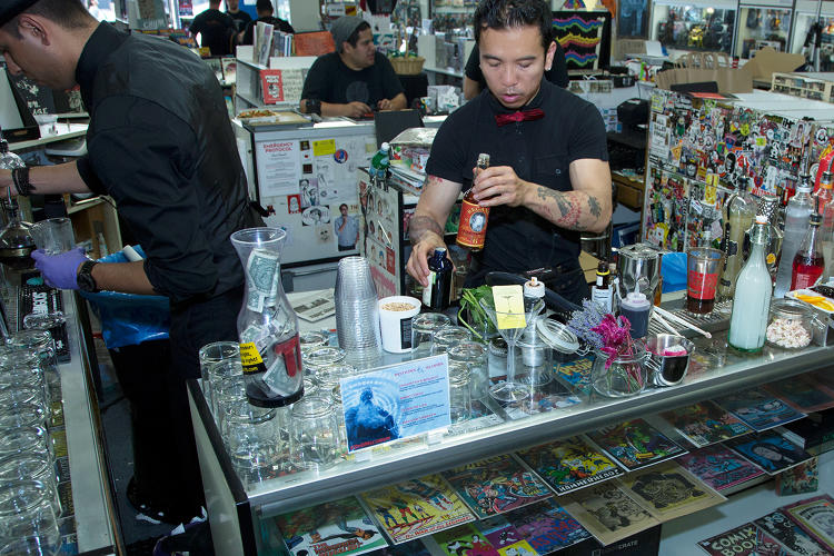 <p>BTG Bartending's Michael Ng mixes drinks.</p>