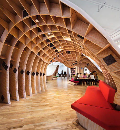 <p>New York-based Barbarian Group built a long worktable that snakes around the entire office and lifts at certain points to create private nooks.</p>
