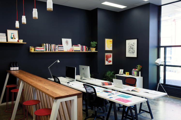 <p>The charcoal walls at Australian graphic design firm Jen Clark Design make the space feel like home while also displaying the studio's aesthetic.</p>