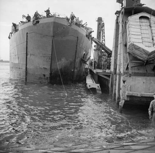 <p>Ship docked at Mulberry harbour. 1944 .</p>