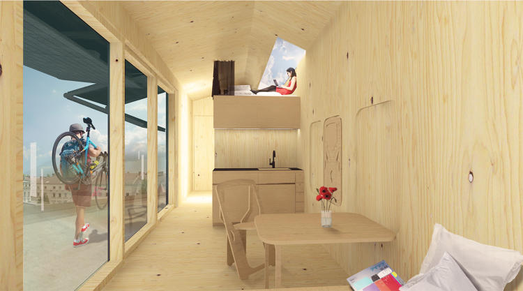 <p>Inside, there is a kitchen on one side, a bathroom on the other, and stairs leading up to a simple loft.</p>
