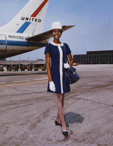 <p>United Air Lines stewardess in uniform by Jean Louis, 1968</p>