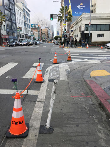 <p>A more permanent solution could be as simple as adding bollards or planters along existing lanes.</p>