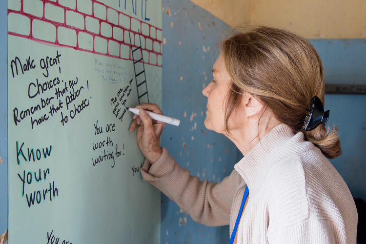 <p><strong>Gloria Steinem</strong> participating in Room to Read's Zambia program.</p>