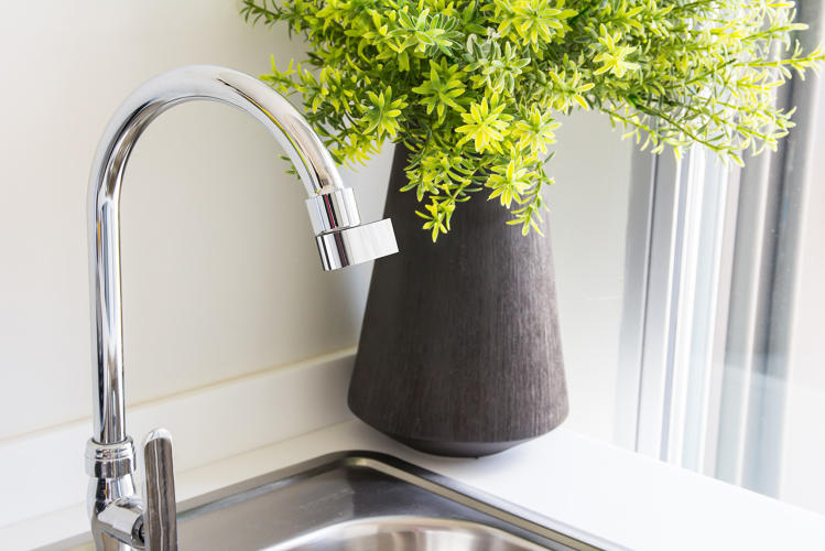 <p>From certain angles, the water flowing out of a new faucet attachment is nearly invisible.</p>