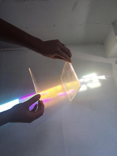 <p>Marjan van Aubel's Dichoric Light changes from a mirror to a colorful light thanks to a special film applied to the surface that reacts to light.</p>