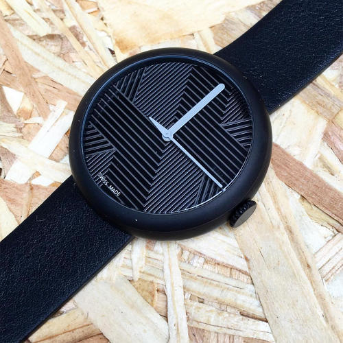 <p>This watch by <a href=&quot;http://objest.com/&quot; target=&quot;_blank&quot;>Objest</a> doesn't have any numbers, but the laser-etched geometric patterns intersect with the edge of the face where the hours are usually printed.</p>