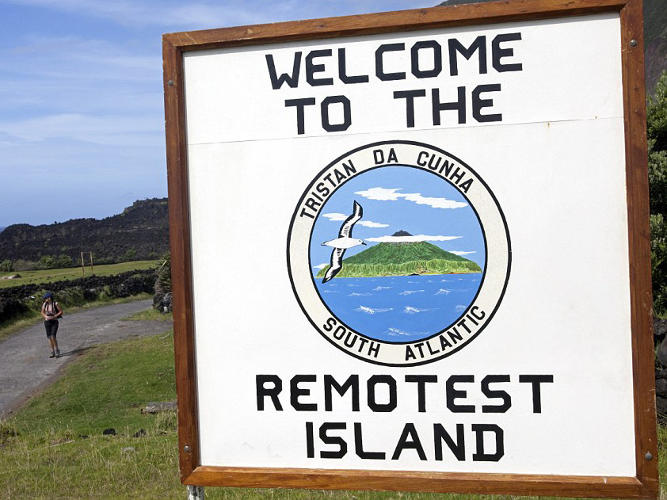 <p>A sign on Tristan da Cunha declaring it the remotest island.</p>