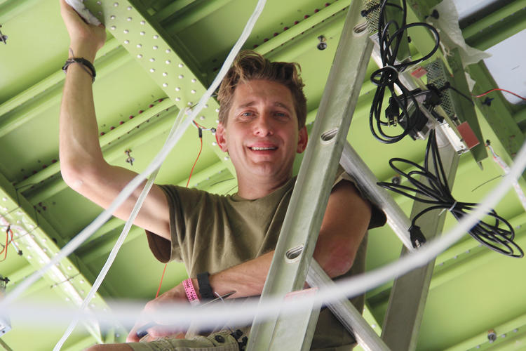 <p>San Francisco inventor <strong>Dave Mathews</strong> adjusts lighting on the hull ceiling.</p>