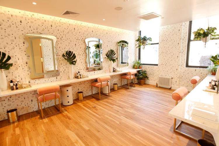 <p>The makeup room's walls are covered in custom wallpaper with cute illustrations.</p>
