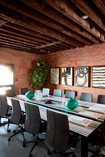 <p>Artwork from felters in Nepal adorn the executive conference room.</p>
